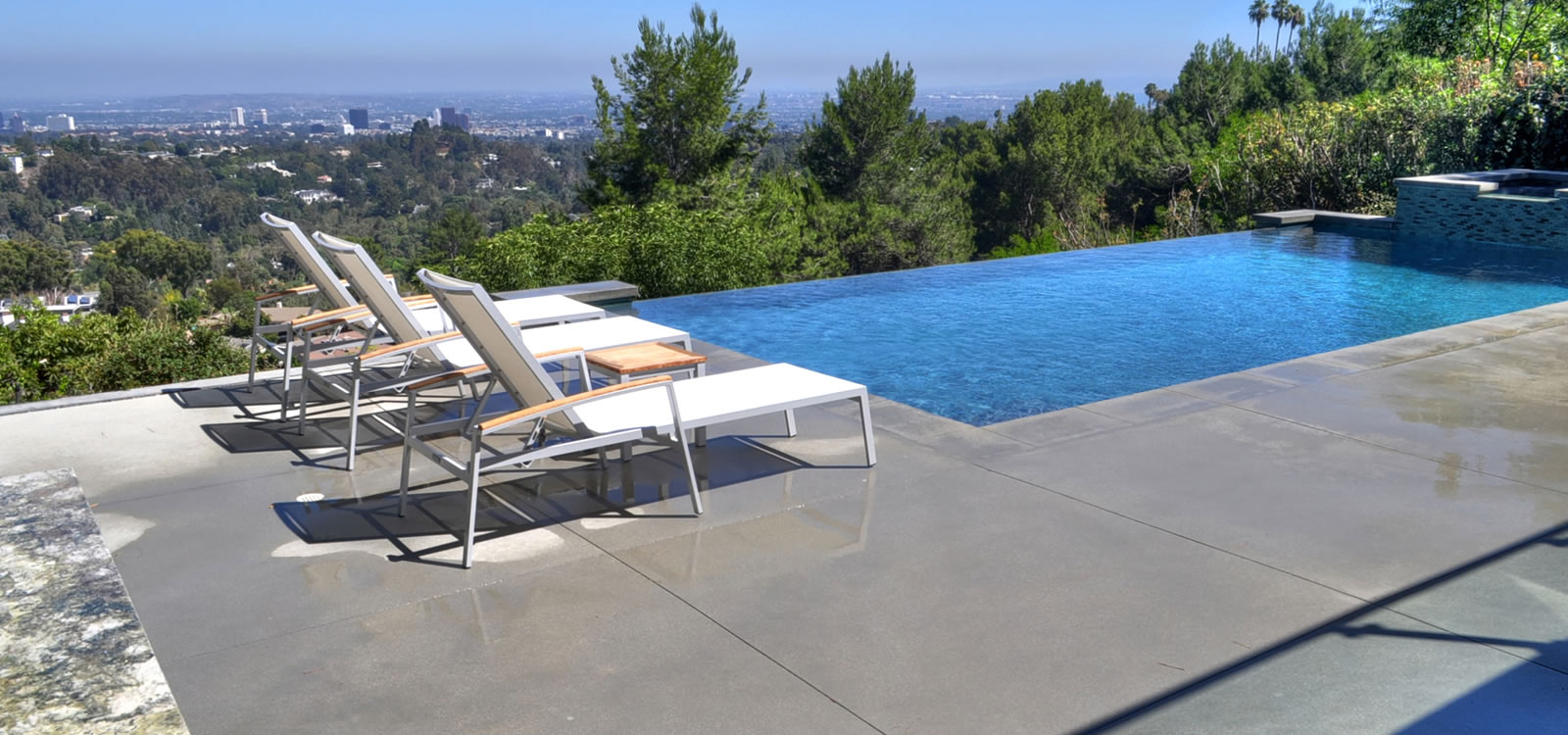 Los Angeles Vanishing Edge Pool Design W/ Elevated Spa Custom Tile