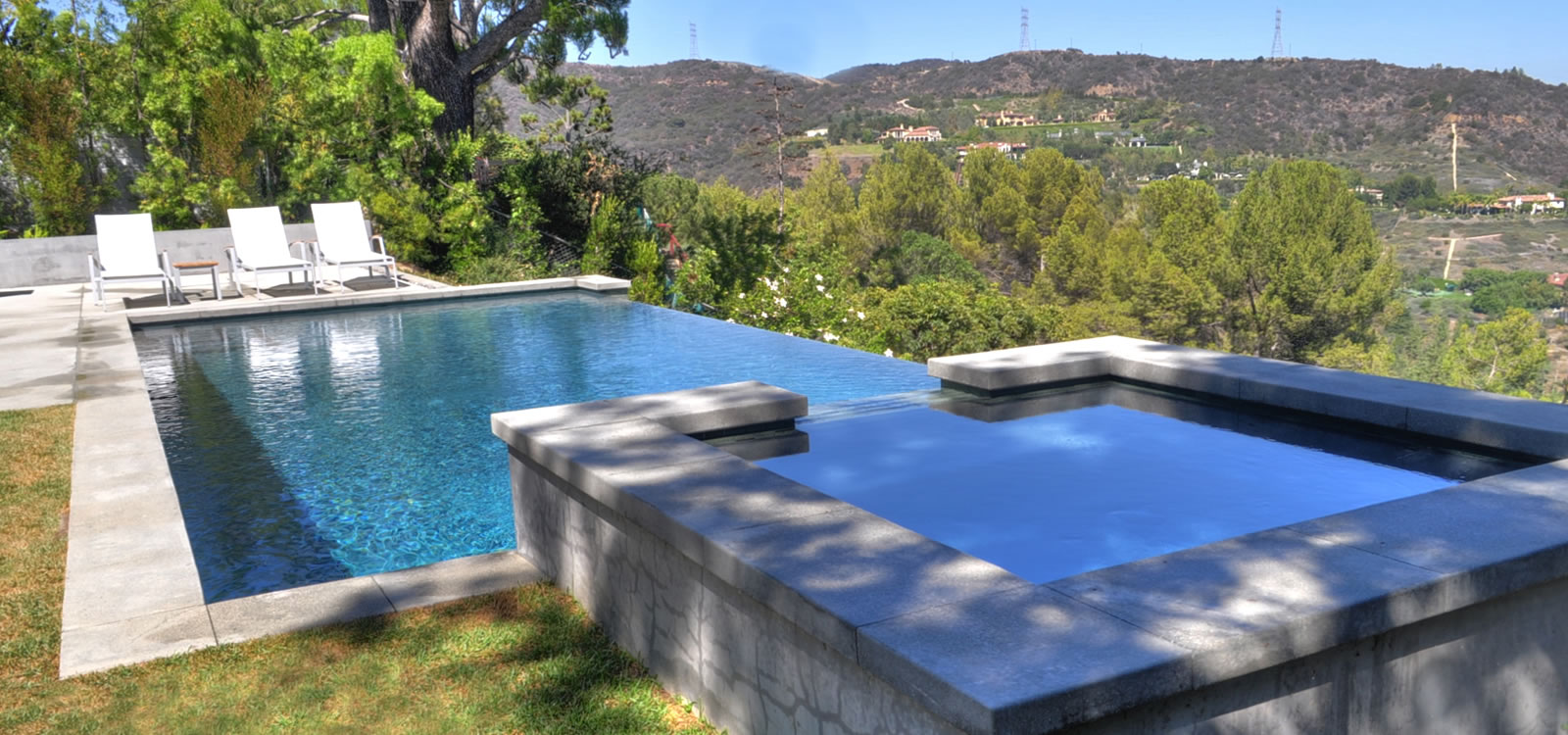 Gentil Los Angeles Vanishing Edge Pool Design W/ Elevated Spa Custom Tile
